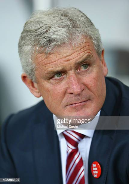 Mark Hughes manager of Stoke City looks on prior to the Barclays Premier League match between Swansea City and Stoke City at Liberty Stadium on...
