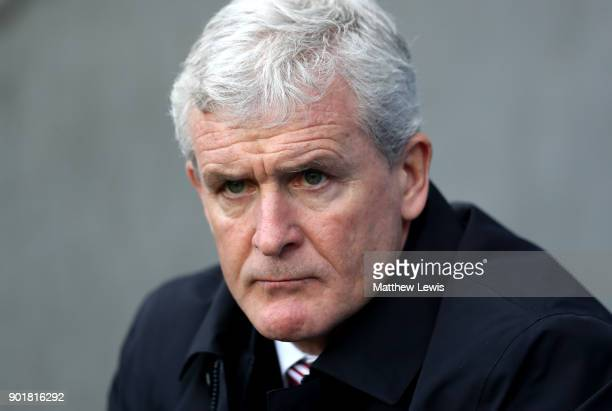 Mark Hughes Manager of Stoke City looks on prior to The Emirates FA Cup Third Round match between Coventry City and Stoke City at Ricoh Arena on...