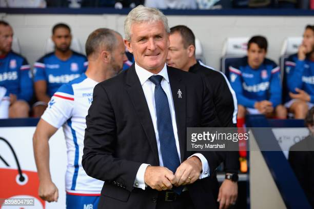 Mark Hughes Manager of Stoke City looks on prior to the Premier League match between West Bromwich Albion and Stoke City at The Hawthorns on August...