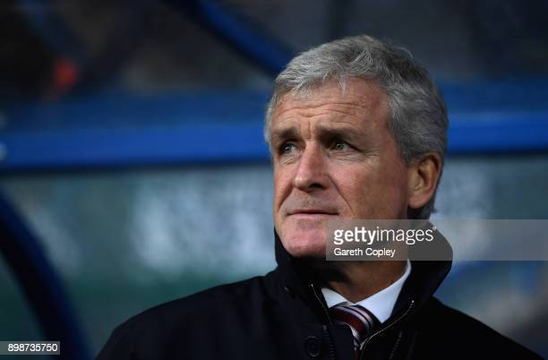 Mark Hughes Manager of Stoke City looks on prior to the Premier League match between Huddersfield Town and Stoke City at John Smith's Stadium on...