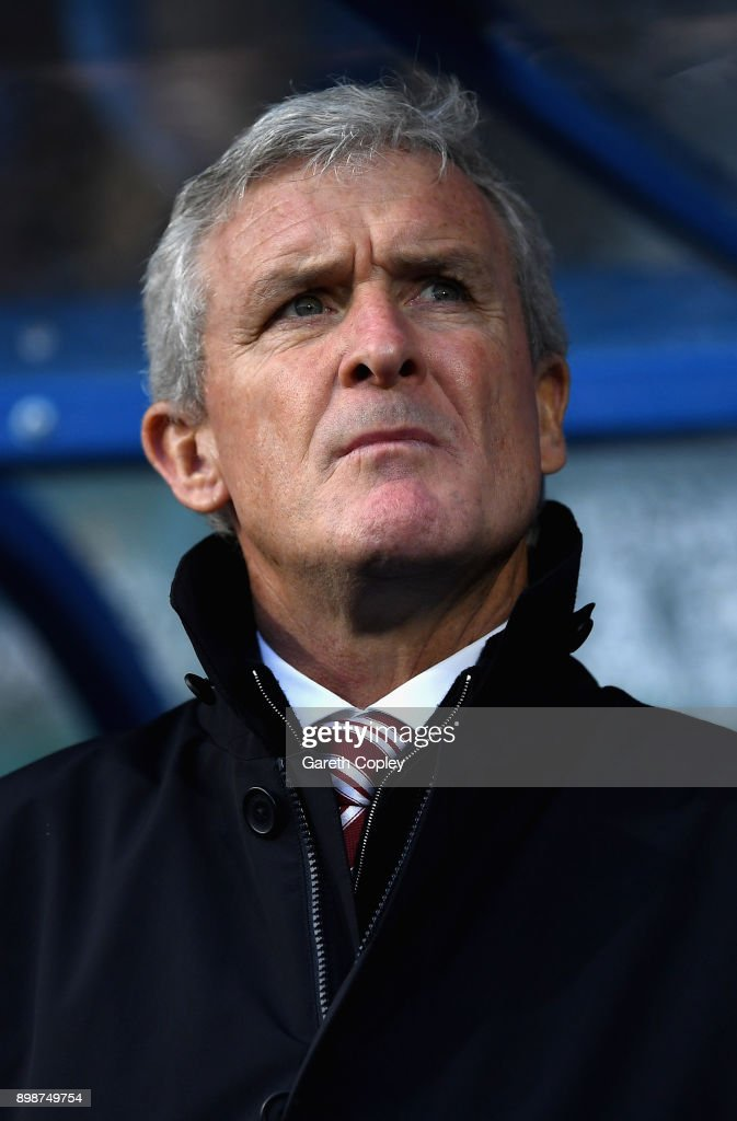 Mark Hughes, Manager of Stoke City looks on prior to the Premier League match between Huddersfield Town and Stoke City at John Smith's Stadium on December 26, 2017 in Huddersfield, England.