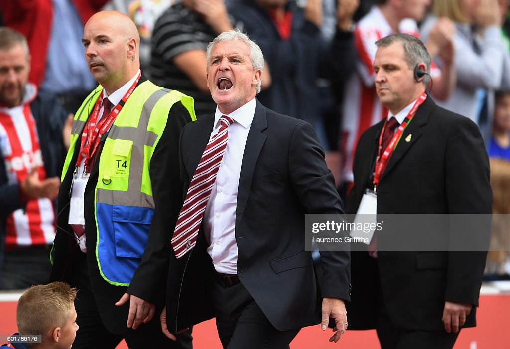 Mark Hughes, Manager of Stoke City reacts after being sent to the stands during the Premier League match between Stoke City and Tottenham Hotspur at Britannia Stadium on September 10, 2016 in Stoke on Trent, England.