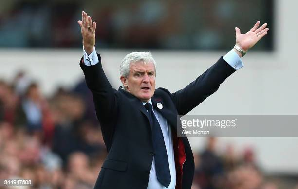 Mark Hughes Manager of Stoke City reacts during the Premier League match between Stoke City and Manchester United at Bet365 Stadium on September 9...