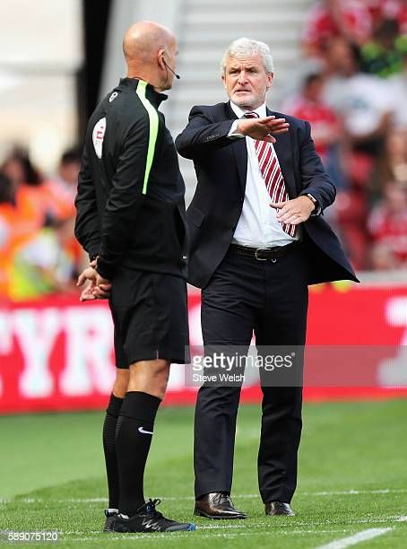 Mark Hughes Manager of Stoke City reacts to forth offical Nigel Miller during the Premier League match between Middlesbrough and Stoke City at...