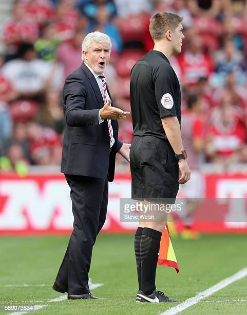 Mark Hughes Manager of Stoke City reacts to the fourth offical during the Premier League match between Middlesbrough and Stoke City at Riverside...