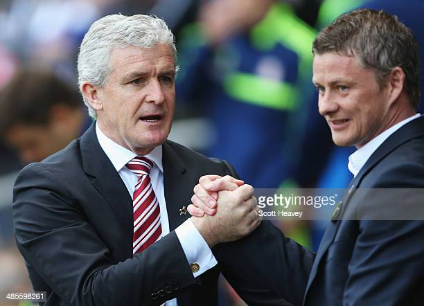 Mark Hughes manager of Stoke City shakes hands with Ole Gunnar Solskjaer manager of Cardiff City prior to the Barclays Premier League match between...