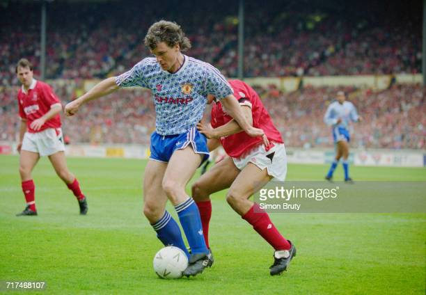 Mark Hughes of Manchester Utd holds onto the ball from the Nottingham Forest defender Des Walker during their Rumbelows Football League Cup Final...