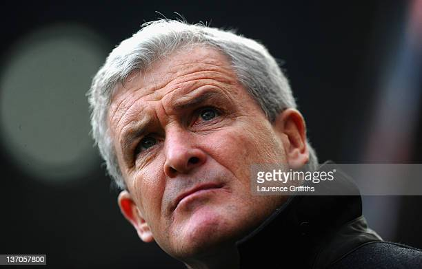 Mark Hughes of Queens Park Rangers takes to the bench for his first game in charge during the Barclays Premier League match between Newcastle United...