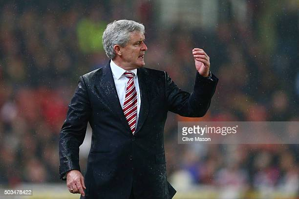 Mark Hughes the Manager of Stoke City reacts during the Capital One Cup semi final first leg match between Stoke City and Liverpool at the Britannia...