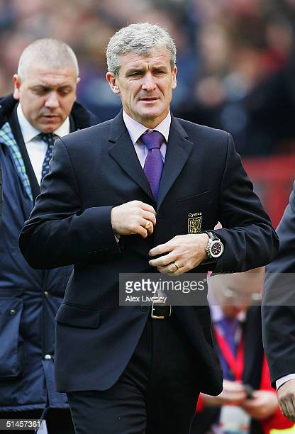 Mark Hughes the manager of Wales leaves the pitch after losing the 2006 World Cup Qualifying match between England and Wales at Old Trafford on...