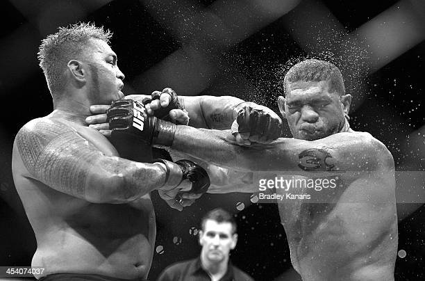 Mark Hunt connects with a punch during the UFC Brisbane bout between Mark Hunt and Antonio 'Big Foot' Silva of Brazil at the Brisbane Entertainment...