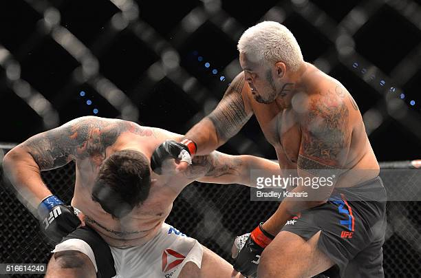 Mark Hunt delivers the knock out punch against Frank Mir during their UFC Heavyweight Bout at UFC Brisbane on March 20 2016 in Brisbane Australia