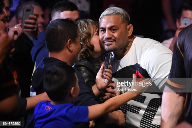 Mark Hunt of New Zealand greets his family before he enters the Octagon prior to facing Derrick Lewis in their heavyweight fight during the UFC Fight...