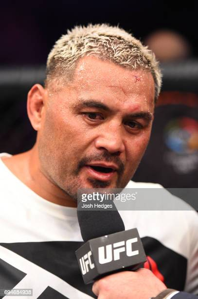 Mark Hunt of New Zealand is interviewed by Brian Stann after defeating Derrick Lewis in their heavyweight fight during the UFC Fight Night event at...