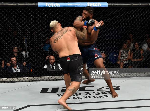 Mark Hunt of New Zealand punches Curtis Blaydes in their heavyweight bout during the UFC 221 event at Perth Arena on February 11 2018 in Perth...