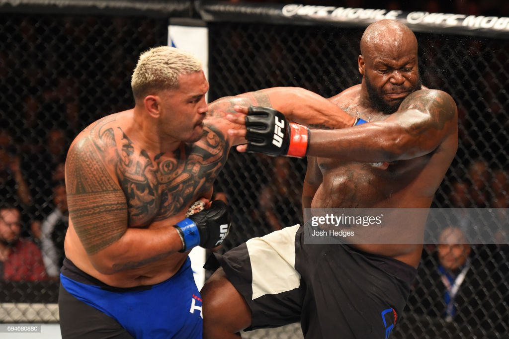 Mark Hunt of New Zealand punches Derrick Lewis in their heavyweight fight during the UFC Fight Night event at the Spark Arena on June 11, 2017 in Auckland, New Zealand.