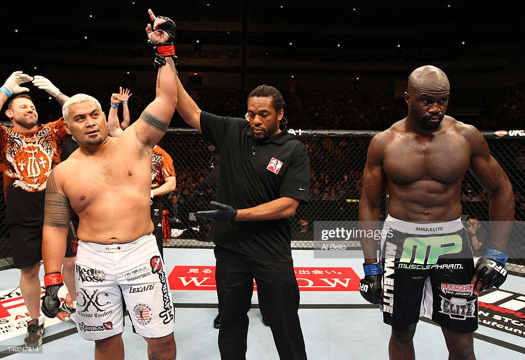 Mark Hunt (L) reacts after his knockout victory over Cheick Kongo (R) during the UFC 144 event at Saitama Super Arena on February 26, 2012 in Saitama, Japan.