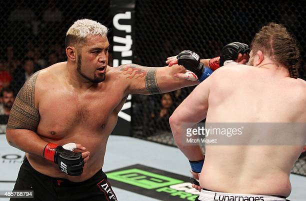 Mark Hunt throws a punchat Roy Nelson in their heavyweight bout during the UFC Fight Night event inside the Saitama Arena on September 20 2014 in...