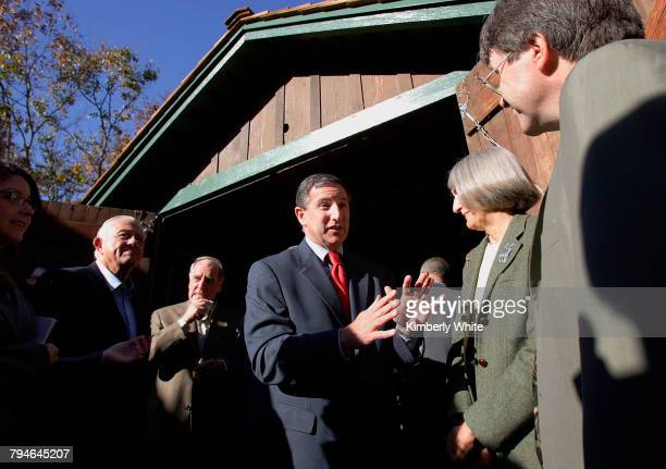 Mark Hurd , Chief Executive Officer of Hewlett-Packard Company, chats with people on the opening day of the HP Garage Museum. Hurd and others stand...