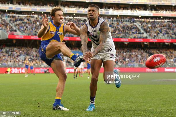 Mark Hutchings of the Eagles gets his kick away under pressure from Bradley Hill of the Dockers during the round 20 AFL match between the West Coast...