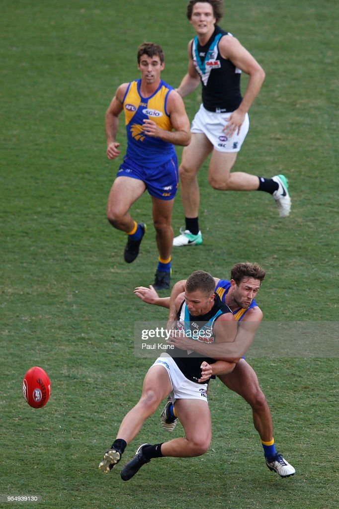 Mark Hutchings of the Eagles tackles Dan Houston during the round seven AFL match between the West Coast Eagles and the Port Adelaide Power at Optus Stadium on May 5, 2018 in Perth, Australia.