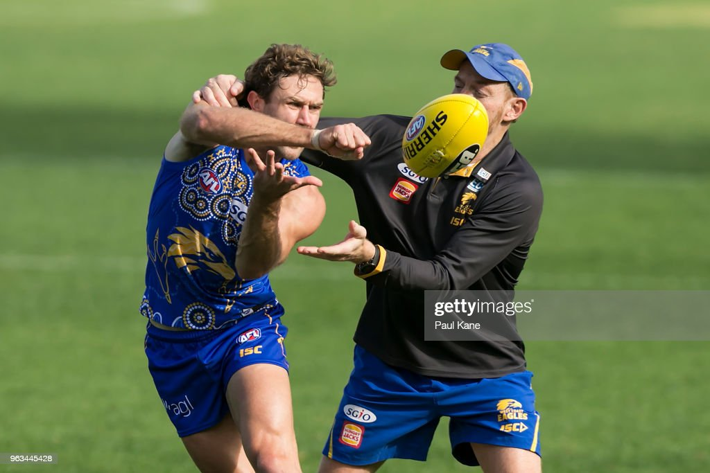 Mark Hutchings works on a drill with Adrian Hickmott during a West Coast Eagles AFL training session at Subiaco Oval on May 29, 2018 in Perth, Australia.