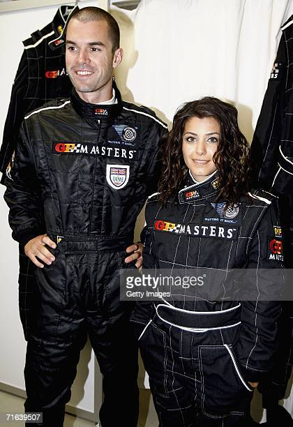 Mark Hynes poses with Katie Melua as she gets ready to be driven around the track by him in the two seater GP masters car during the GP Masters of...