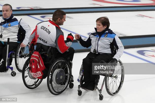 Mark Ideson from Canada and Aileen Neilson from Scotland react during the World Wheelchair Curling Championship 2017 test event for PyeongChang 2018...