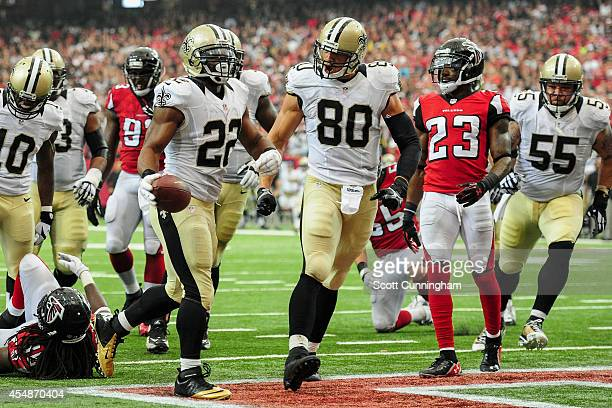 Mark Ingram celebrates a touchdown with Jimmy Graham of the New Orleans Saints in the second half against the Atlanta Falcons at the Georgia Dome on...