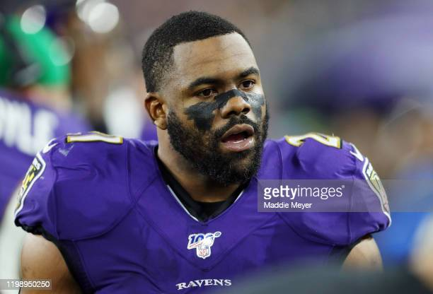 Mark Ingram II of the Baltimore Ravens reacts on the sideline during the first half in the AFC Divisional Playoff game against the Tennessee Titans...