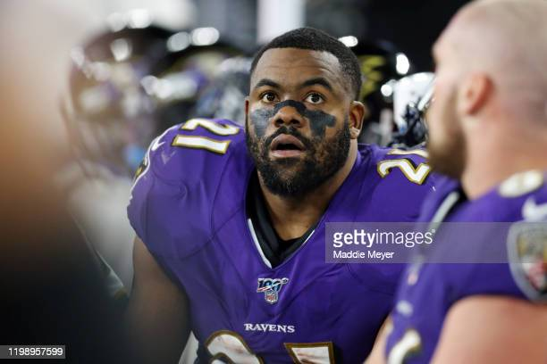Mark Ingram II of the Baltimore Ravens reacts on the sideline during the AFC Divisional Playoff game against the Tennessee Titans at M&T Bank Stadium...