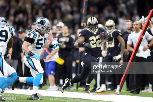 Mark Ingram ll of the New Orleans Saints runs the ball against Luke Kuechly of the Carolina Panthers during the first half of the NFC Wild Card...