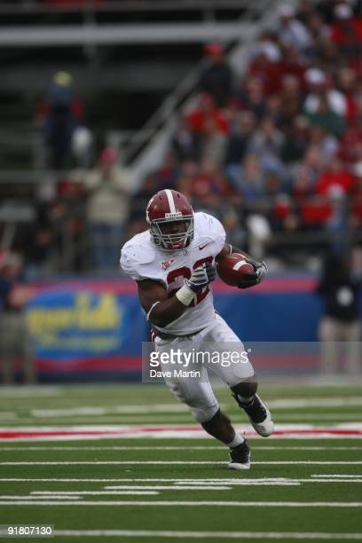 Mark Ingram of the Alabama Crimson Tide runs for a 36yard touchdown in their college football game against the Mississippi Rebels at VaughtHemingway...