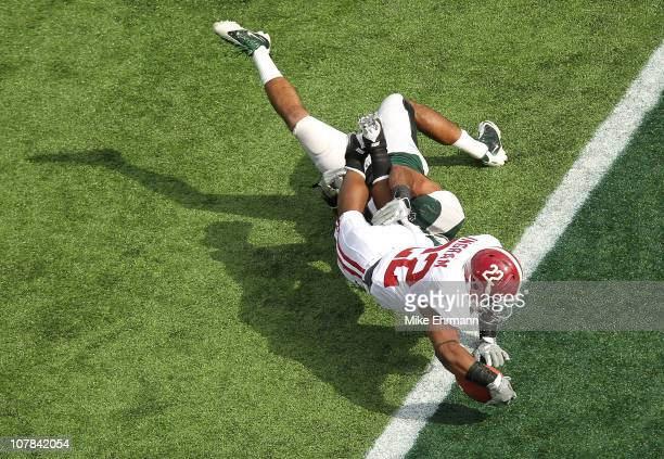 Mark Ingram of the Alabama Crimson Tide scores a touchdown during the Capitol One Bowl against the Michigan State Spartans at the Florida Citrus Bowl...