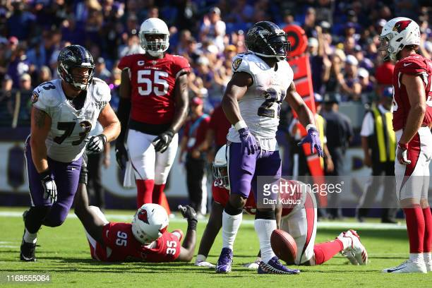 Mark Ingram of the Baltimore Ravens celebrates a first down against the Arizona Cardinals during the second half at MT Bank Stadium on September 15...