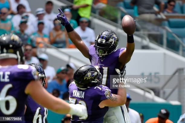 Mark Ingram of the Baltimore Ravens celebrates after scoring a touchdown in the first quarter against the Miami Dolphins at Hard Rock Stadium on...