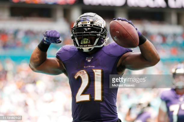 Mark Ingram of the Baltimore Ravens celebrates after scoring a touchdown against the Miami Dolphins during the second quarter at Hard Rock Stadium on...