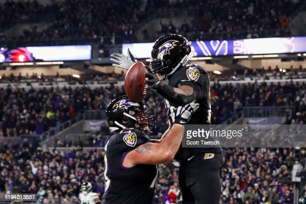 Mark Ingram of the Baltimore Ravens celebrates with Marshal Yanda after scoring a twopoint conversion against the New York Jets during the first half...