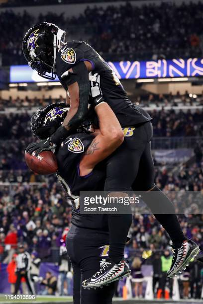 Mark Ingram of the Baltimore Ravens celebrates with Marshal Yanda after scoring a two-point conversion against the New York Jets during the first...