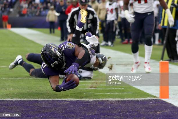 Mark Ingram of the Baltimore Ravens scores a fourth quarter touchdown in front of Cornell Armstrong of the Houston Texans at MT Bank Stadium on...