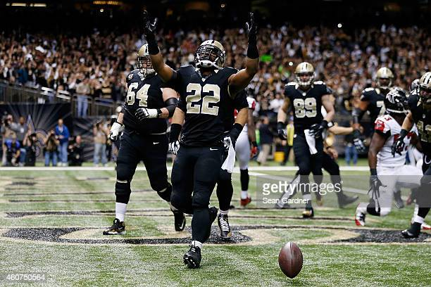 Mark Ingram of the New Orleans Saints celebrates a touchdown during the first quarter of a game against the Atlanta Falcons at the MercedesBenz...