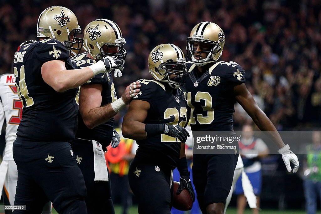 Mark Ingram #22 of the New Orleans Saints celebrates after scoring a touchdown against the Tampa Bay Buccaneers at the Mercedes-Benz Superdome on December 24, 2016 in New Orleans, Louisiana.