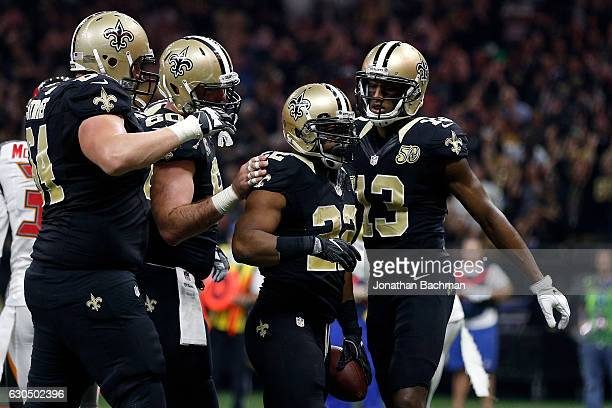 Mark Ingram of the New Orleans Saints celebrates after scoring a touchdown against the Tampa Bay Buccaneers at the MercedesBenz Superdome on December...