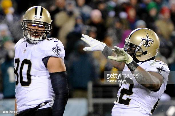 Mark Ingram of the New Orleans Saints celebrates with teammate Jimmy Graham after running for a 4 yard touchdown in the third quarter against the...