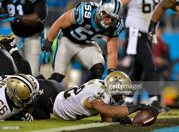 Mark Ingram of the New Orleans Saints dives into the end zone for a touchdown during the second quarter of their game against the Carolina Panthers...