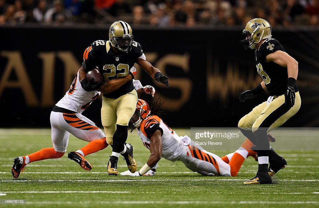 Mark Ingram #22 of the New Orleans Saints drives the ball for a first down against the Cincinnati Bengals during the first quarter at Mercedes-Benz Superdome on November 16, 2014 in New Orleans, Louisiana.