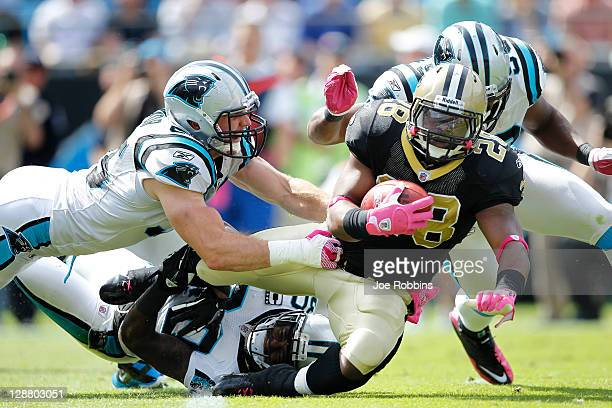 Mark Ingram of the New Orleans Saints gets tackled by Dan Connor of the Carolina Panthers during the first half at Bank of America Stadium on October...