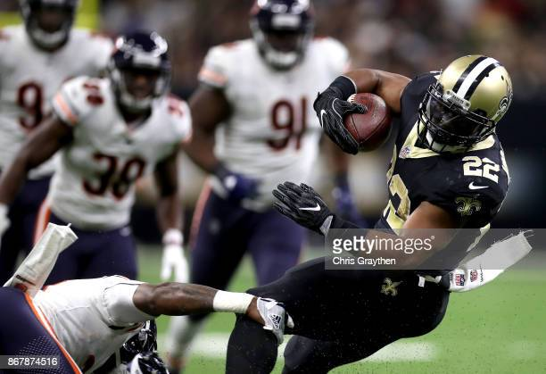 Mark Ingram of the New Orleans Saints is tackeld by Eddie Jackson of the Chicago Bears during the second quarter at the MercedesBenz Superdome on...