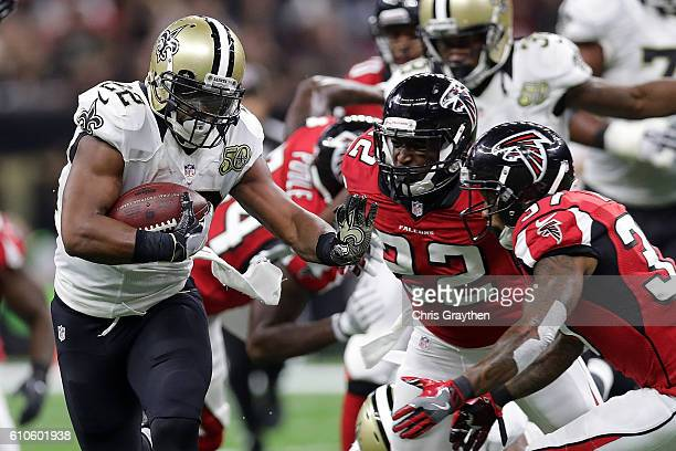 Mark Ingram of the New Orleans Saints is tackled by Keanu Neal of the Atlanta Falcons at the MercedesBenz Superdome on September 26 2016 in New...