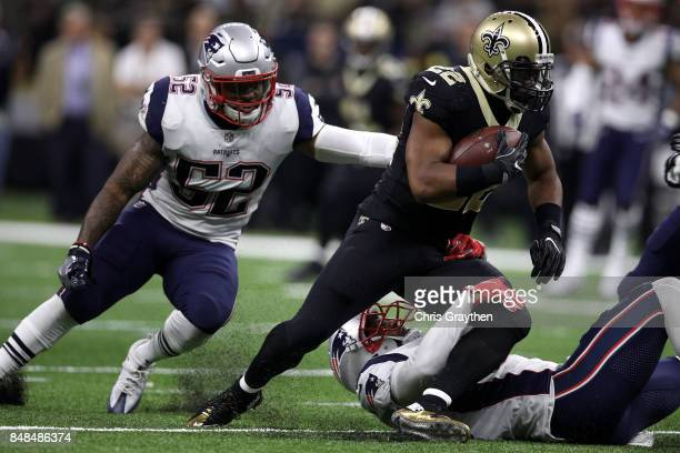 Mark Ingram of the New Orleans Saints is tackled by Patrick Chung of the New England Patriots at the MercedesBenz Superdome on September 17 2017 in...